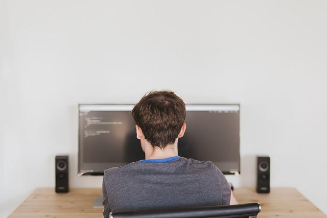 it computer service professional working on desktop computer