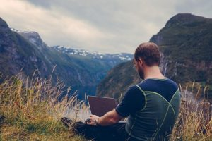 it guy on mountain with laptop